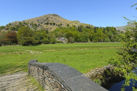 crag: Easedale Valley and Helm Crag near Grasmere village in Lake District National Park England