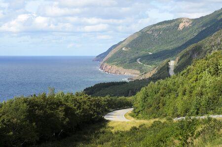 View of Cabhot Trail from boat Cape Breton Island Nova Scotia Canada photo