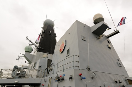 destroyer: PORTSMOUTH, HAMPSHIRE, ENGLAND - MAY 5: HMS Dragon (D35) Type 45 Destroyer on May 5, 2012 in Portsmouth, Hamphire, England. HMS Dragon is the fourth of the Navy?s six £1bn Type 45 destroyers and the latest to be commissioned into the Fleet. She was launch