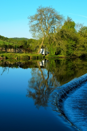 Newby Bridge, England - May 26th, 2012: View of weir on River Leven Lake District National Park Cumbria England.  Stock Photo - 14138560