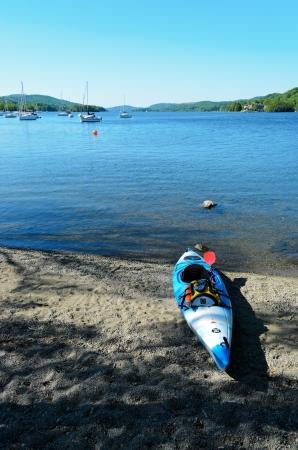 Bowness, England - May 26th, 2012: Perception Acadia kayak on beach in Bowness on Windermere Lake District National Park England.  Stock Photo - 14138561