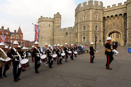 berkshire: WINDSOR, BERKSHIRE, ENGLAND - MAY 19: Royal Marines band outside Windsor Castle on Queens Diamond Jubilee Great Parade on May 19, 2012 in Windsor, Berkshire, England.