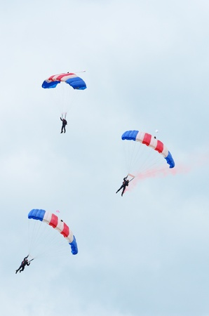 raf: RAF COSFORD, SHROPSHIRE, ENGLAND - JUNE 17: Unidentified RAF Falcons parachute display team members displaying their directional control skills on June 17, 2012 in RAF Cosford, Shropshire, England.   Editorial