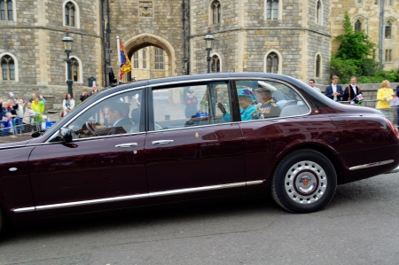 WINDSOR, BERKSHIRE, ENGLAND - MAY 19: Her Majesty the Queen leaving Windsor castle by car after Queens Diamond Jubilee Great Parade on May 19, 2012 in Windsor, Berkshire, England.