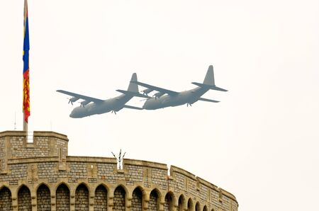 berkshire: WINDSOR, BERKSHIRE, ENGLAND - MAY 19: Two Hercules flying over Windsor Castle on Queens Diamond Jubilee Great Parade May 19, 2012 in Windsor, Berkshire, England.  Editorial
