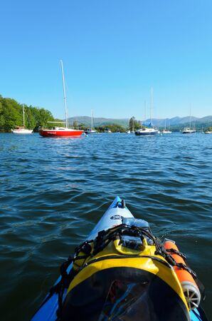 Lake Windermere, England - May 26th, 2012: View of sailing boats on Lake Windermere from kayak in Lake District National Park England. Stock Photo - 15245779