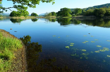 Near Sawery, England - May 26th, 2012  Esthwaite Water is a first class, well managed Trout fishery  It is a beautiful natural 280 acre water situated in the heart of the English Lake District with excellent facilities for boat or bank fishing Stock Photo - 17038063