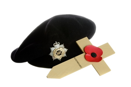 appeal: Remembrance Day Poppy on wooden cross with military beret Editorial