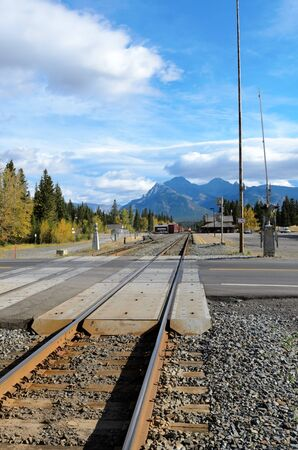 Banff, Canada - October 1st, 2012: Canadian Pacific freight train approaching Banff level crossing