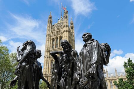 rodin: London, England - June 30th, 2012: Les Bourgeois de Calais sculpture by Auguste Rodin  completed in 1889 in front of Victoria Tower London England. Editorial