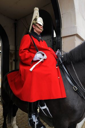 cavalryman: London, England - July 14th, 2012: A mounted trooper of the Household Cavalry guarding the entrance to Horse Guards