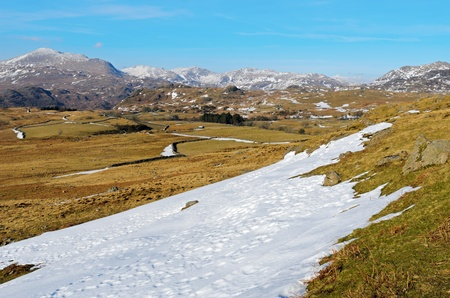 Snow covered Birker Fell and mountains near Birkerthwaite in Lake District National Park England Stock Photo - 21080042