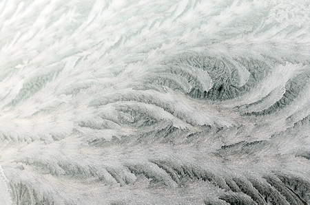 sub zero: Frost pattern on car windscreen caused by sub zero temperarure and strong winds Stock Photo