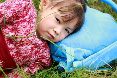 Cute little girl lying on the grass