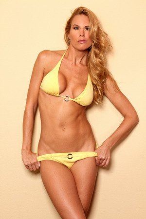 Portrait of sexy mature bikini fitness woman in studio photo