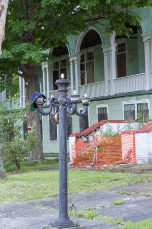 Abandoned historic hotel with antique street lamp Stok Fotoğraf