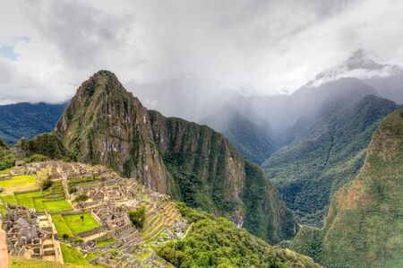 Machu Pichu with storm rolling in
