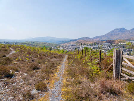 The town and surrounding coutryside of Blaenau Ffestiniog on a bright spring day in April.