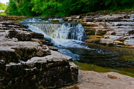 The waters of the River Ribble become blurred as they pass over Stainforth Force in the Yorkshire Dales 版權商用圖片