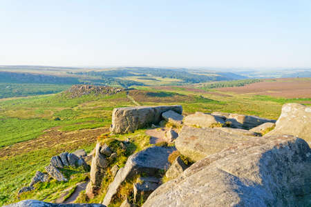 From the gritstone rocks of Higger Tor, over Hathersage Moor to Carl Wark Hillfort on a hazy summer morning