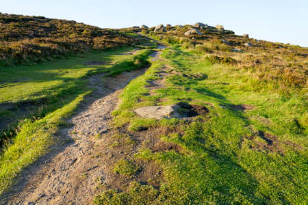 A narrow, steep, footpath up to the top of Higger Tor in the Derbyshire Peak District