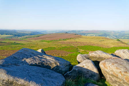 A hazy summer morning on top of Higger tor looking across Hathersage Moor
