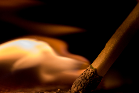 bengal light: Macro shot of lit match shows flame coming from head of match Stock Photo