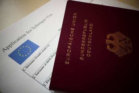 EU Schengen Visa application form with a german passport, a document For applying to entry in the European Union.