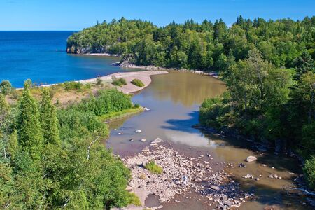 the entrance of the beaver river into lake superior, beaver bay, minnesota. photo