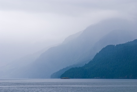 a foggy coastline, on british columbias west coast, canada.