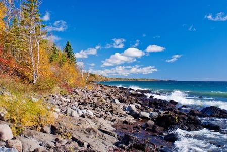 autumn, and crashing waves, on north shore of lake superior, minnesota.