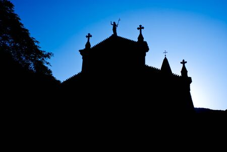 a church silhouetted in the morning glow of sunrise, riomaggiore, italy. Stock Photo - 10385650