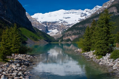 louise: mount victoria rises above lake louise, in banff nation park, alberta, canada.