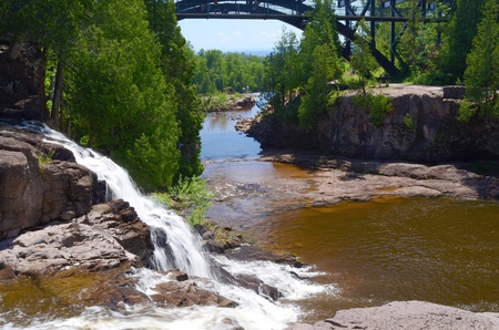 minnesota: the gooseberry river flows over upper gooseberry falls, where it eventually enters into lake superior, on its north shore, minnesota.