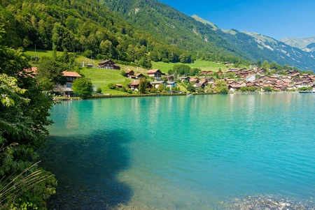 lake shore: looking across the turquoise waters of lake brienze to the oberried shoreline, switzerland. Stock Photo