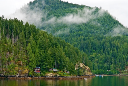 british weather: old cottages, overlooking the marine waters of the inside passage, british columbia.