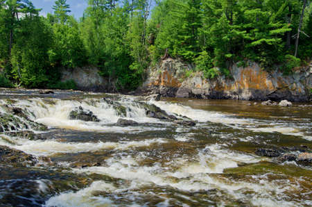 basswood: pipestone falls, cascades down into basswood lake, in the (bwcaw) boundary waters canoe area wilderness, minnesota.