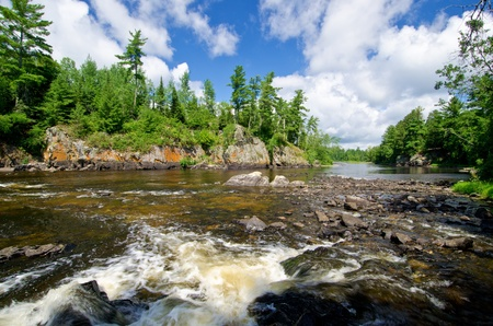 pipestone falls, cascades down into basswood lake, in the (bwcaw) boundary waters canoe area wilderness, minnesota.