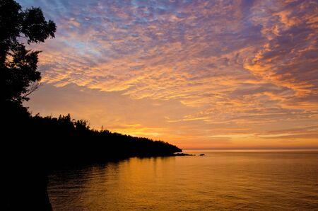 superior: sunrise over shovel point, on the north shore of lake superior, minnesota.