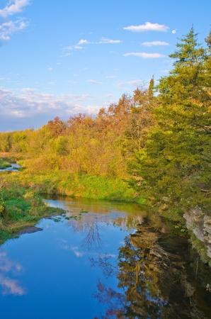 a creek flows along a woodland, in rural illinois, in autumn. Stock Photo