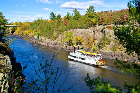 passengers ride a paddleboat up the st.croix river, on the minnesota, wisconsin border.