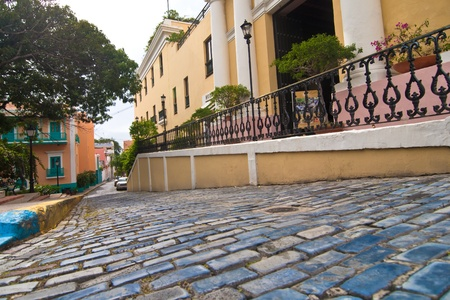 the blue cooblestone streets of old san juan, are typical for this historic city, puerto rico.