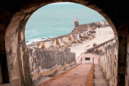 a stairwell leads down to a turret and cannons, at el morro, san juan, puerto rico Stock Photo
