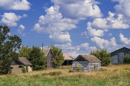 an old abandoned farm slowly decays from the dramatic changing weather of rural central minnesota. photo