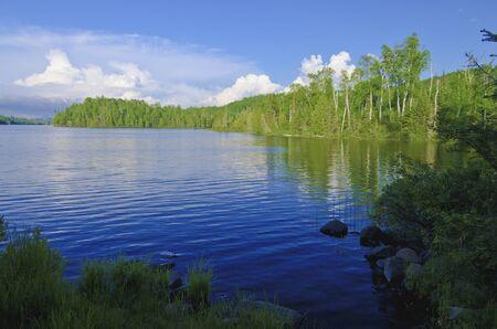 summer thunderheads rise up over bearskin lake, off the gunflint trail, in northeastern minnesota. Stock Photo - 14872289
