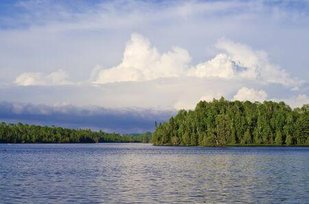 minnesota woods: thunderheads rise up over bearskin lake off the gunflint trail in northeastern minnesota. Stock Photo