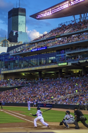 professional baseball being played on a warm summers evening, in downtown minneapolis