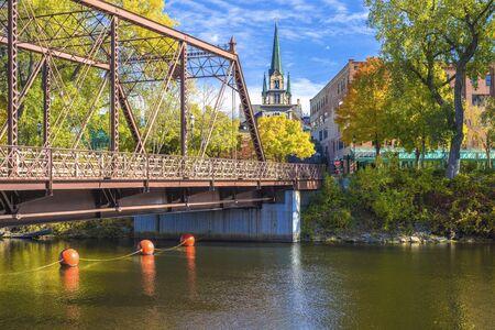 mississippi river: merriam street bridge and our lady of lourdes church, autumn, minneapolis, minnesota.
