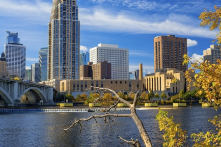 twin tower: minneapolis skyline and saint anthony falls in autumn, minnesota.
