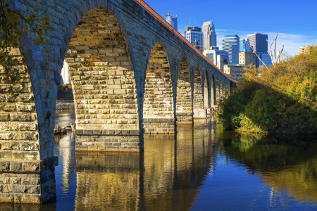 mississippi: the stone arch bridge and minneapolis skyline, autumn, minnesota